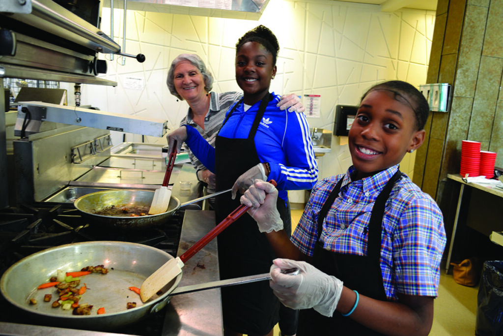Young people in kitchen with a mentor