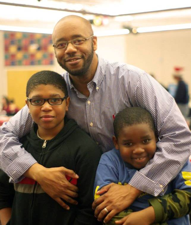 Alonzo Parker with two youth